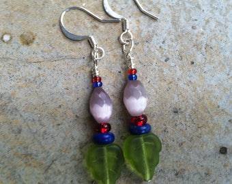 Small beaded green and purple dangle earrings with leaf & flower abstract