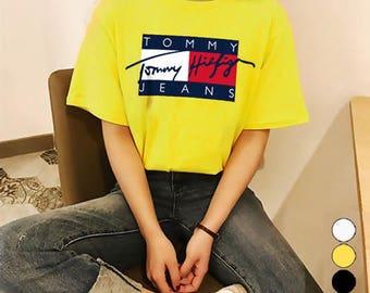 Vintage Tommy Hilfiger Jeans Flag Spelling Sign Logo Unisex T shirt Reprint in 4 color