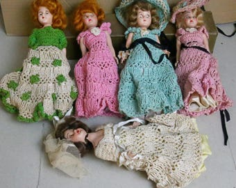 four dolls, eyes move, 8 inch, homemade clothes, head and arms move