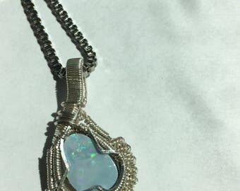 Opal doublet wrapped in sterling silver wire