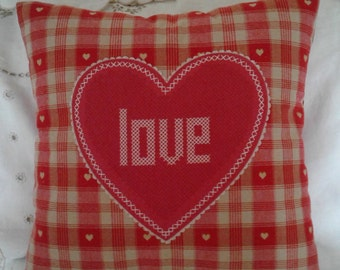 Red/oatmeal heart cushion