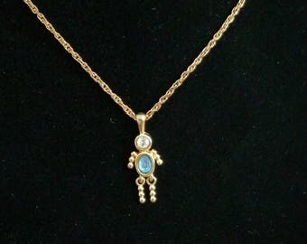 March birthstone charm necklace.  Grandpatent Blue stone, and gold tone.