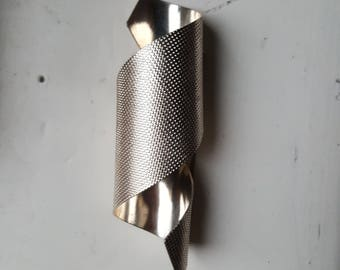 Vintage silver metal spiral brooch
