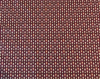 100% Cotton crimson print fabric with black and gray details; for apparel and quilting