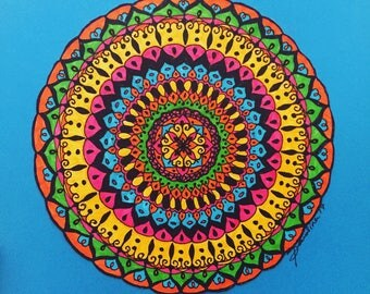 "Hand-drawn mandala; original art blue background. Title ""Africa"""