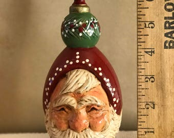 Carved Santa with pine on hat