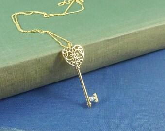 Love Note. Gold Key Necklace. modern necklace. short necklace. key necklace. gold necklace. layering necklace. modern necklace.