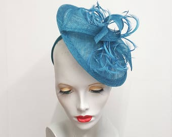 Teal blue saucer tilt sinamay fascinator hat with feather detail - headband fixing ideal weddings races