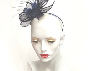 Navy royal blue sinamay and feather fascinator on headband fixing ideal weddings races