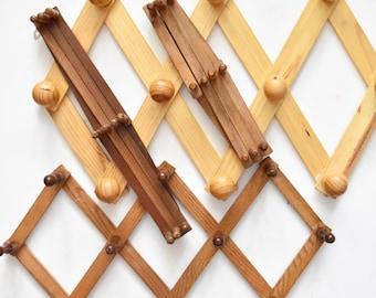 large brown accordion wood peg wall hanging rack // hat display storage // organizer