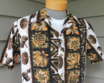 vintage 60's - 70's -Ui-Maikai- Men's vintage Hawaiian shirt. Tiki mask, drum, flower and pineapple print.  Metal 'coin' buttons.  Medium