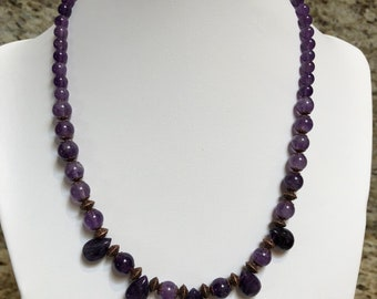 Amethyst Necklace with copper spacer beads and clasp and matching earrings.