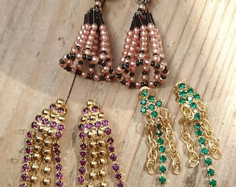 Three pairs of vintage rhinestone and pearl clip on earrings