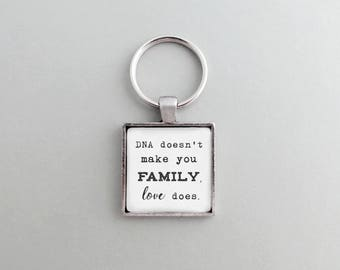 DNA Doesn't Make You Family Love Does Keychain - Silver or Brass