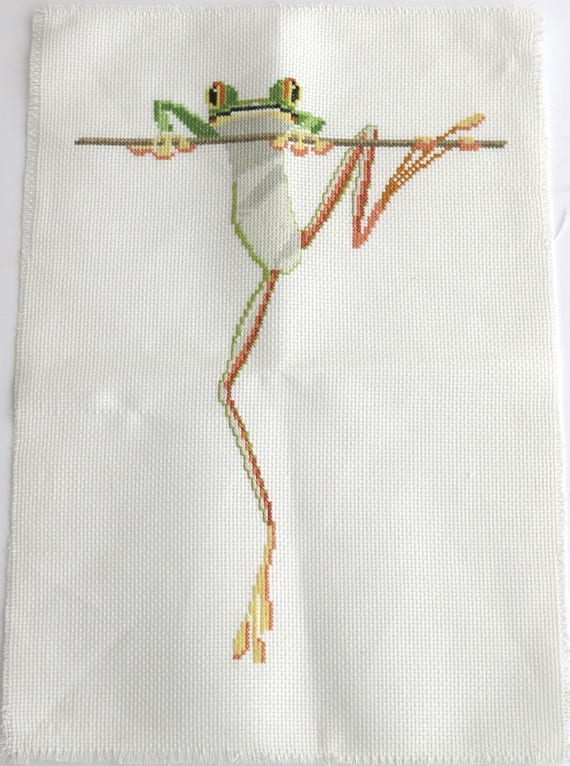 Embroidered green frog climbing a stick, continental and cross stitch, hand embroidered, for framing or other craft purpose, 14 x 10 ins