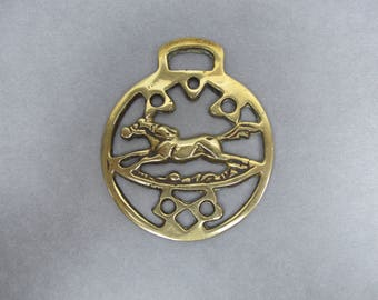 Vintage horse brass. Galloping horse at full stretch.