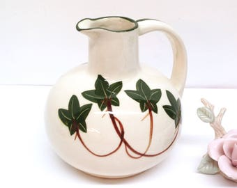 "NASCO IVY PITCHER is a Glazed Off-White Stoneware 6.5"" Pitcher Hand-Painted w/Green Ivy Leaves on Both Sides and Green Rim & Handle Accents"