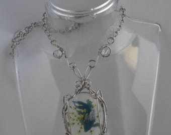 Necklace made of stainless steel and blue koi fish dried flower cabochon in resin