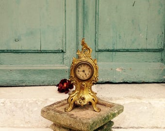 A delightful antique French cast bronze ormolou mantel clock - C1875