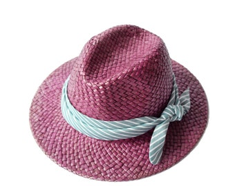 Purple straw hat decorated with a headband