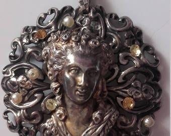 antique silver Medallion
