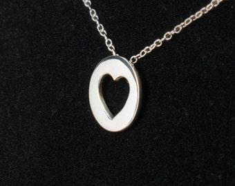 Cut-out heart pendant