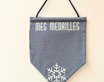 flag hanging medals to ski, blue and white, snowflake