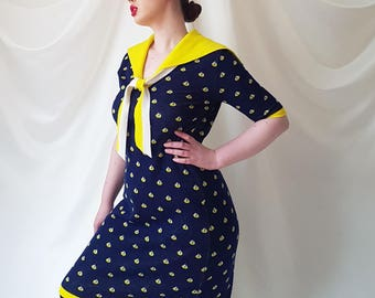 Vintage 1950s Nautical Knitted Knee-Length Dress Featuring a Darling Sail Boat Print & Oversized Sailor Collar In Navy | Yellow | White