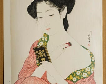 Authentic original antique Japanese woodblock print by HASHIGUCHI GOYO (December 21, 1880 – February 24, 1921) - Woman applying make-up.