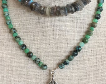 Long beaded necklace with feather pendant