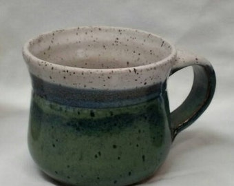 Stoneware mugs hand thrown on the stoneridges of the Ozarks'.