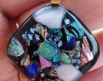 Assorted dichroic glass fused on black base pendant with chain (capped)