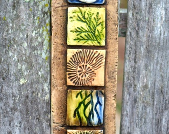 Nature totem garden art shell, spiral, leaf, cast stone