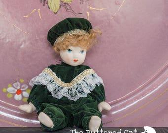 An adorable vintage porcelain doll