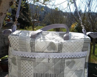 Novelty fabric quilted diaper bag.