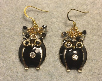Large black enamel and rhinestone owl charm earrings adorned with tiny dangling black and clear Czech glass beads.