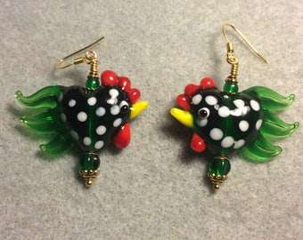 Emerald green with white spots heart shaped lampwork rooster bead earrings adorned with emerald green Czech glass beads.