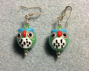 Light green and white lampwork spotted owl bead earrings adorned with light green Chinese crystal beads.