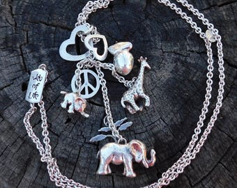Susan Cummings web of life sterling silver necklace rare dimensional charm necklace sold out hand made animal lover.