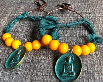 Nomad hoop made of copper wire, chiffon Ribbon, orange glass beads and charm
