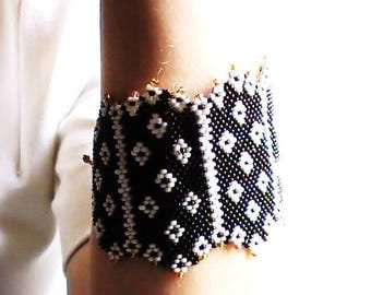 Black cuff with off white and gold tips