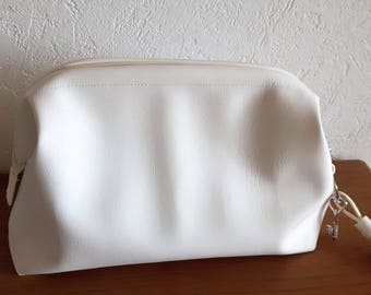 White faux leather toilet seat with rigid clasp