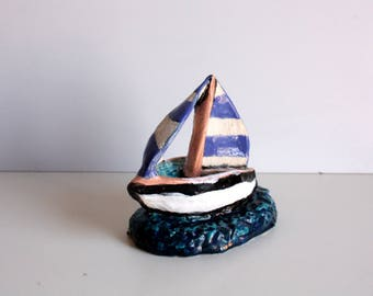 Sailboat in blue and white ceramics, home decoration.