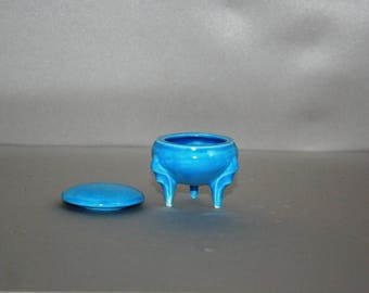 Little Bright Blue Round Box with ornate legs made from a 1960's vintage mold
