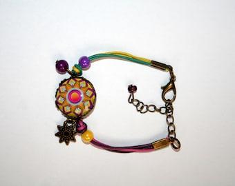Mandala psychedelic purple, yellow bracelet, turquoise and fuchsia