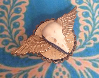 Vintage skull winged bird brooch