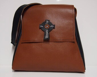Brown and black leather bag.