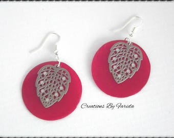 Earrings with silver thru a fuchsia pink sequin and leaf print