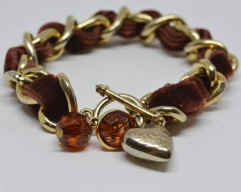 Lovely fabric and gold tone metal bracelet