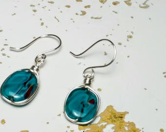 Hand crafted silver wire wrapped aqua swirl earrings by BNMusings